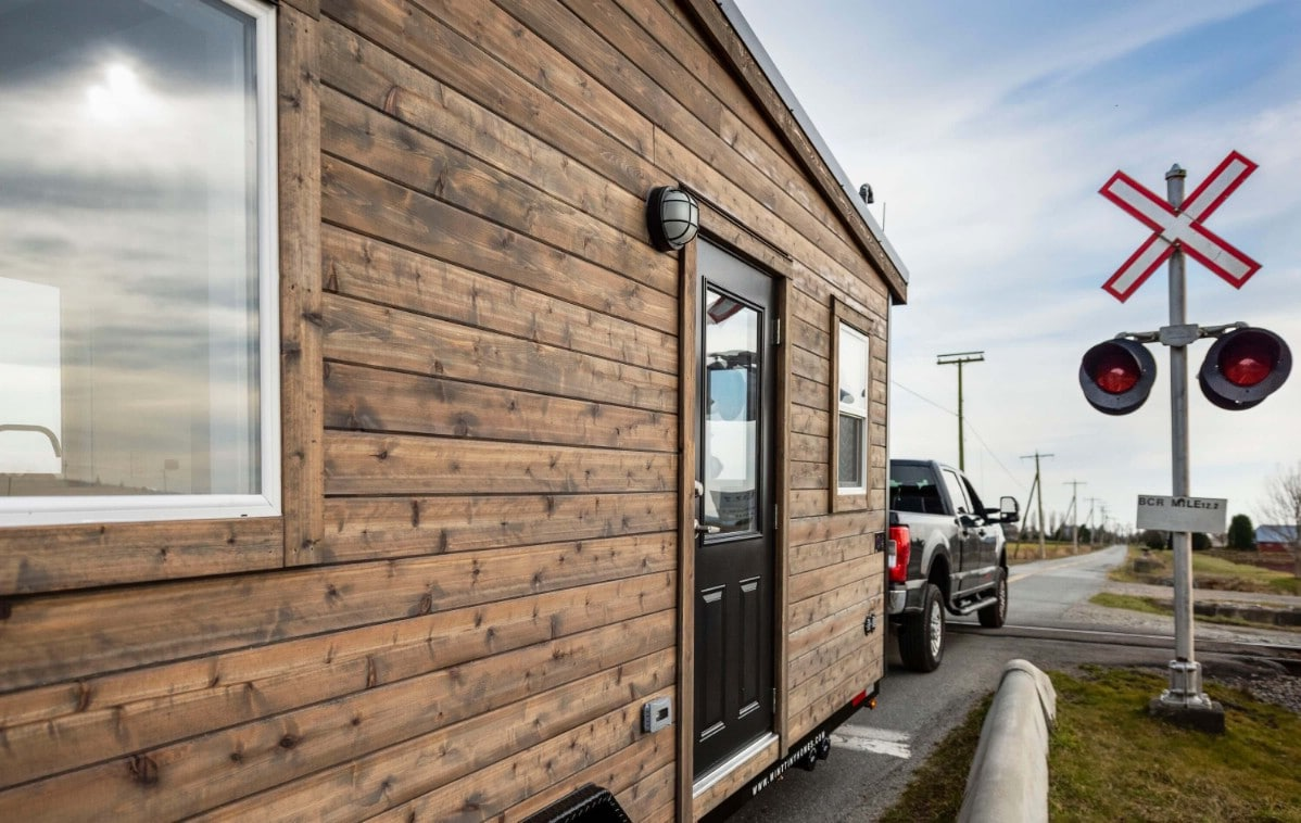 Side of tiny house with wood siding