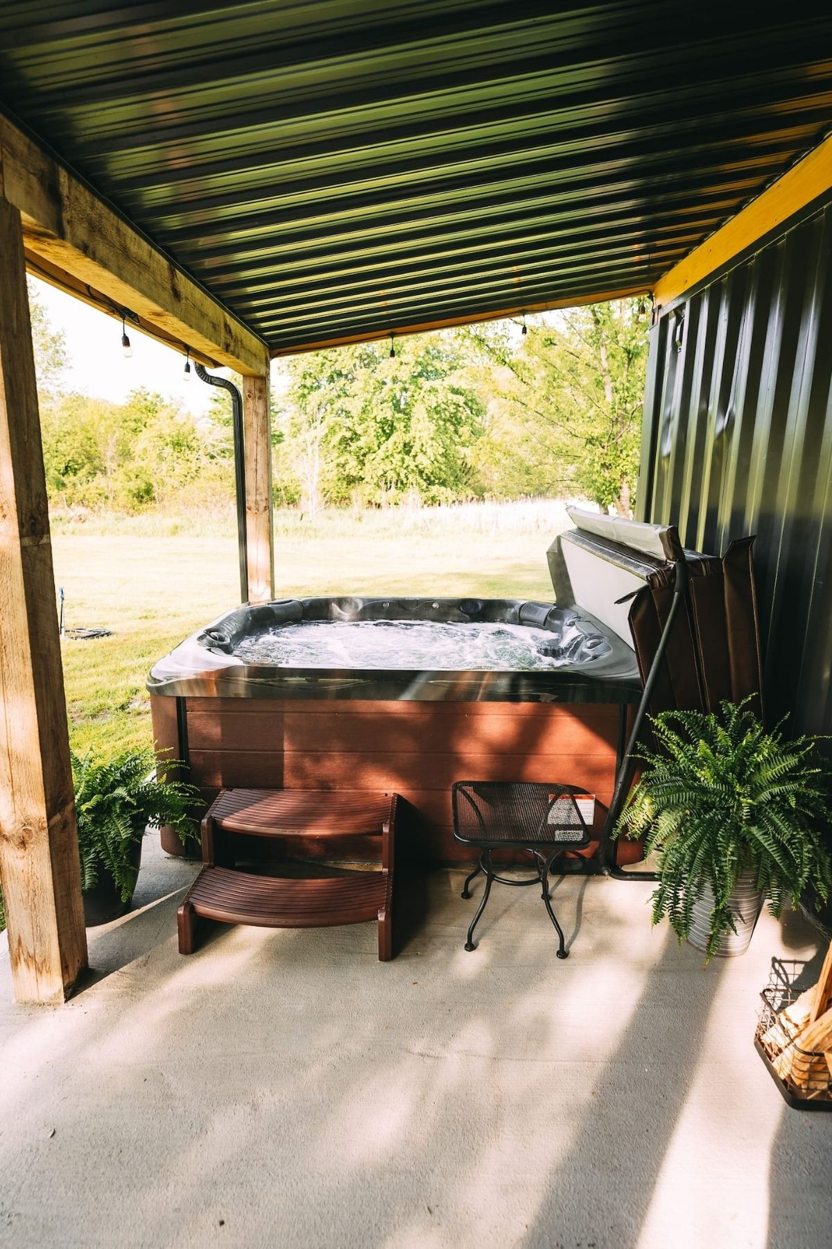 Hot tub on back porch of tiny cottage home