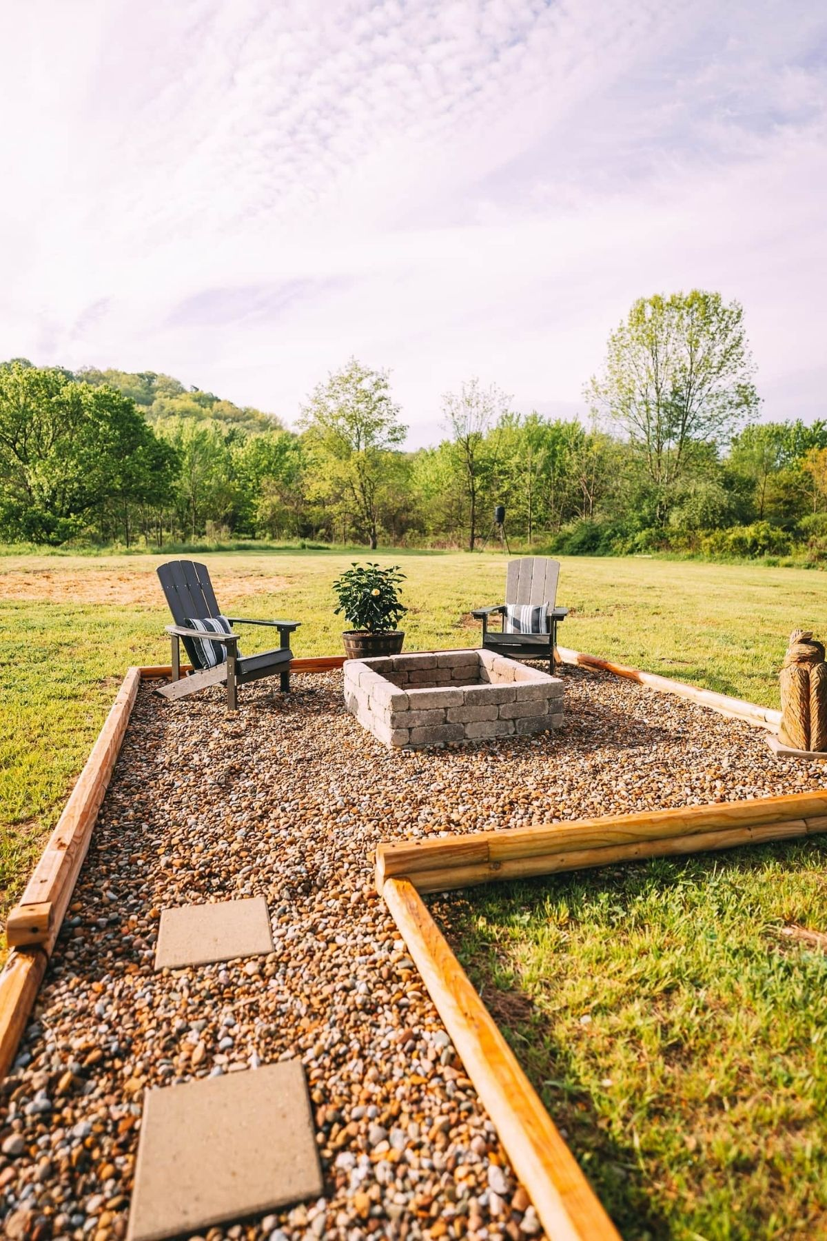 Backyard firepit and chairs in pebble walkway