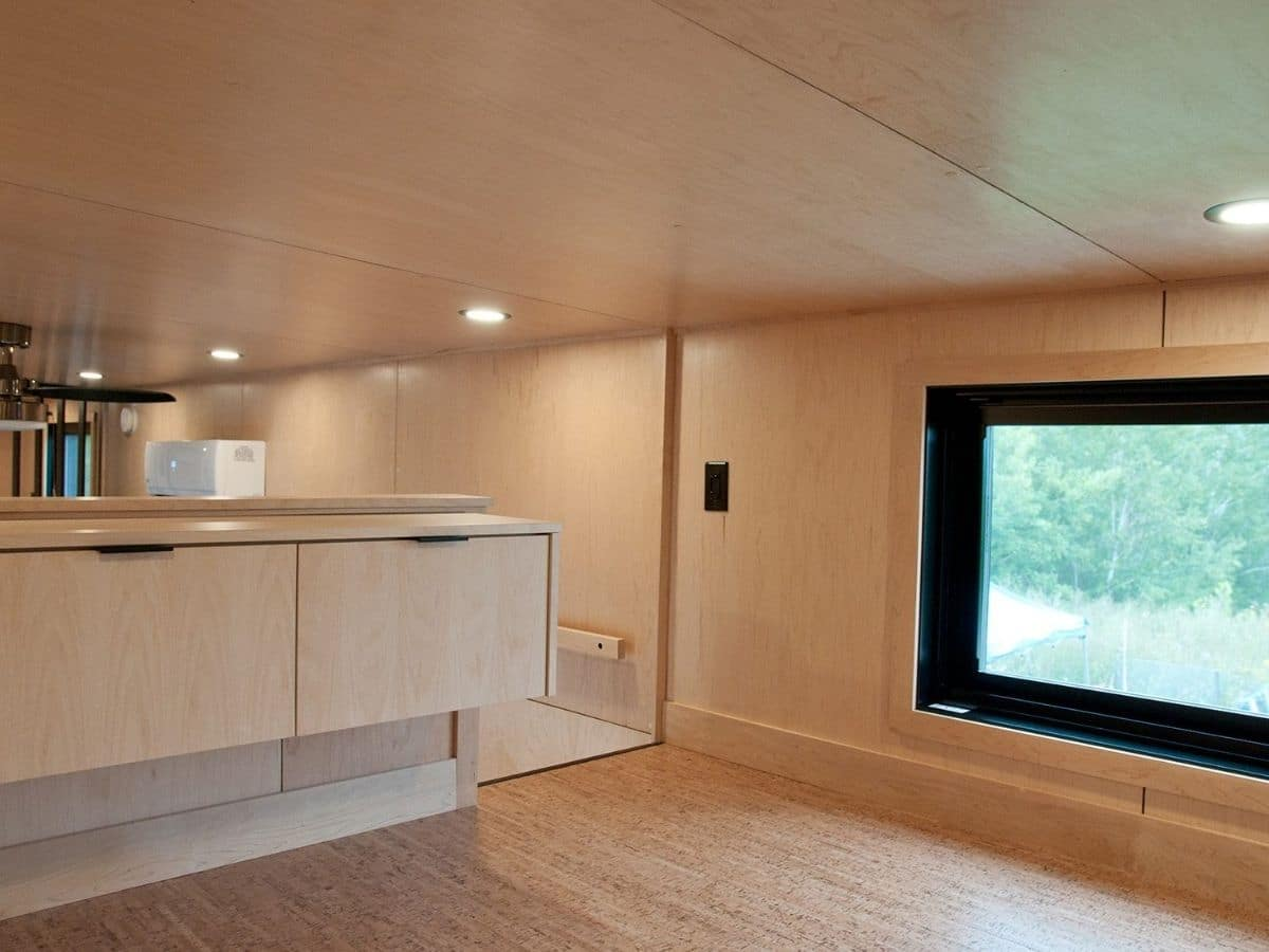 Master loft with natural wood walls and drawers