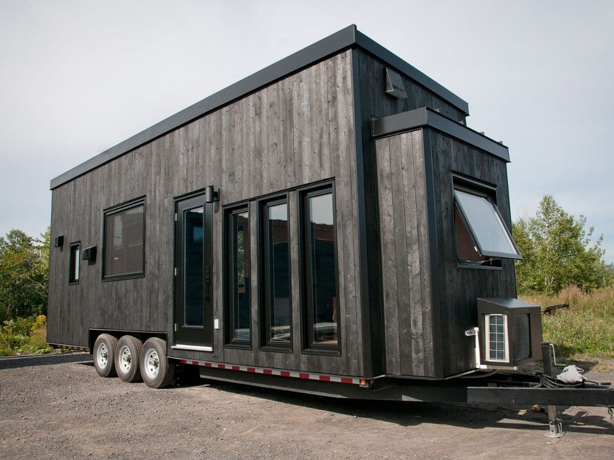 Dark gray tiny house on lot