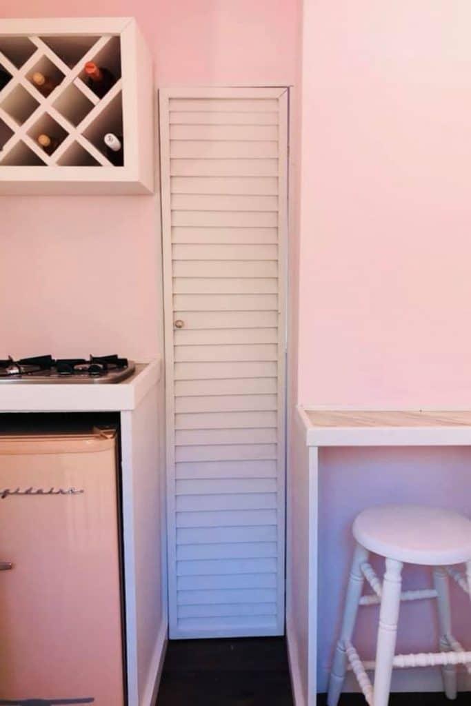 Shutter door by kitchen counter in pink home