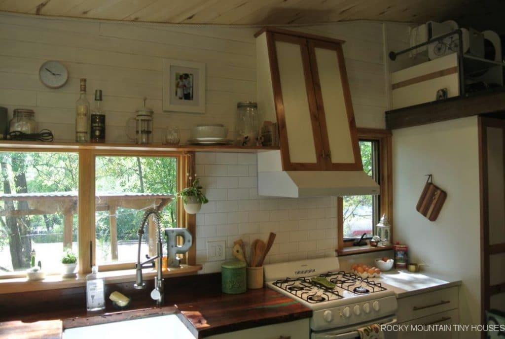 Kitchen with white cabinets and butcherblock counters