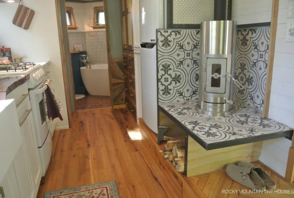 Tile background behind stainless steel wood stove