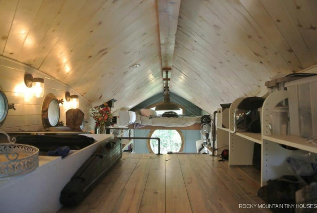 View across loft to end of home with round window
