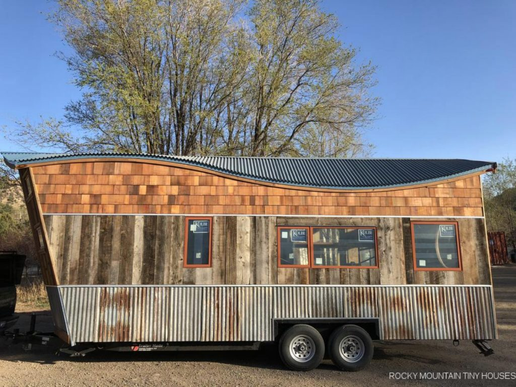 Tiny house with sloped roofline and reclaimed wood siding