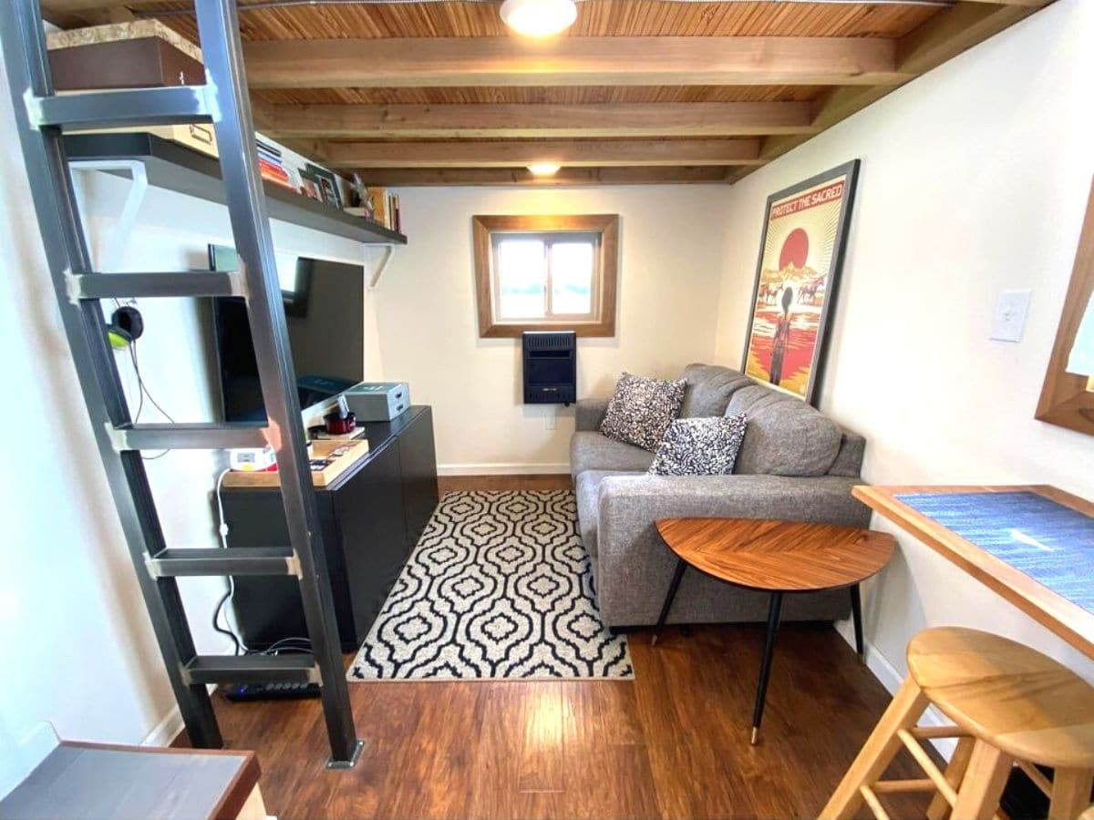 Living room under loft with sofa and entertainment center