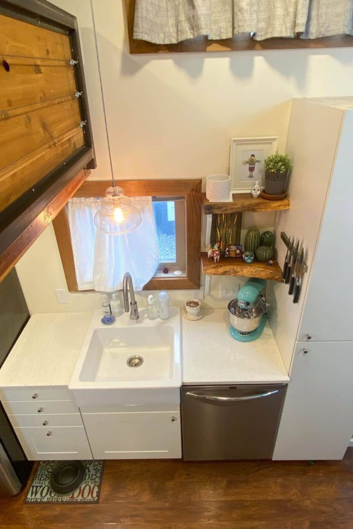 White sink next to stainless steel dishwasher
