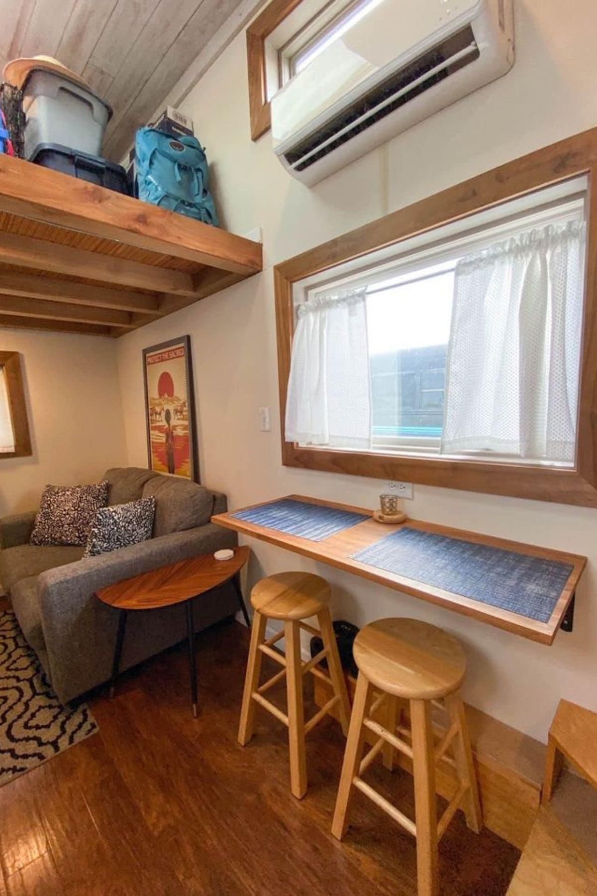 Shelf under window with bar stools