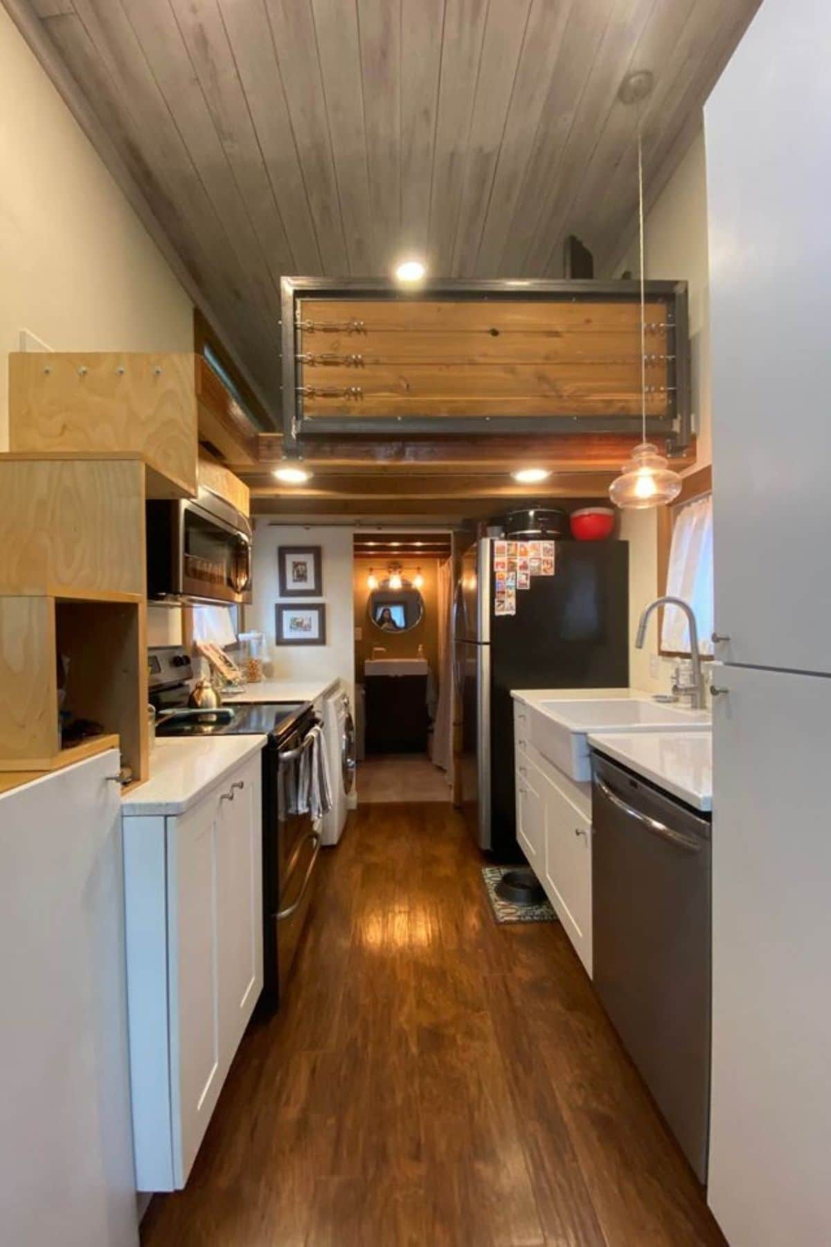 View into tiny house with large loft half wall