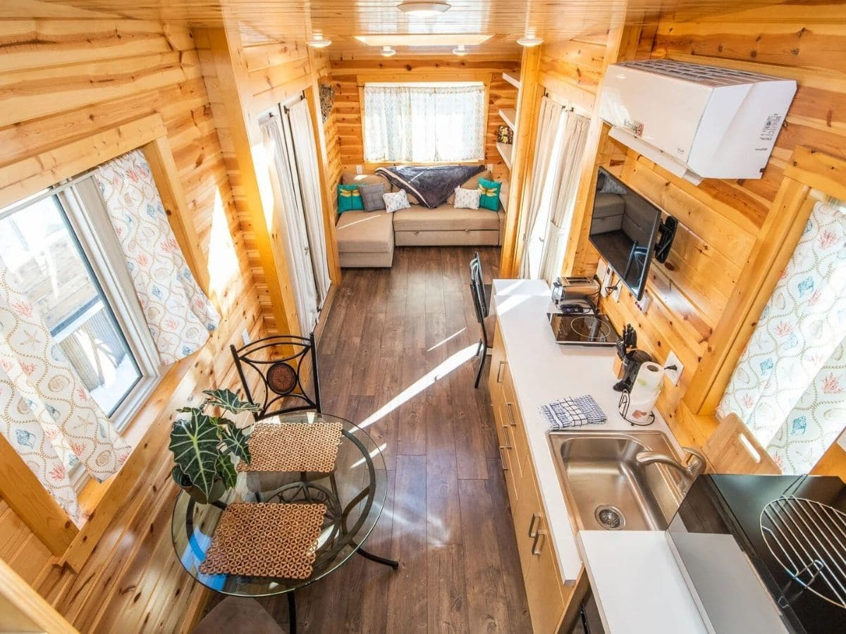 View down into tiny home from loft