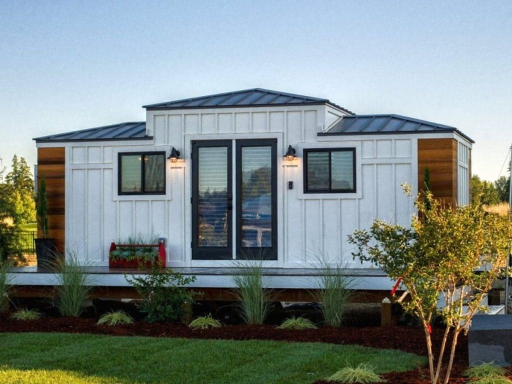 White tiny house with black and wood trim