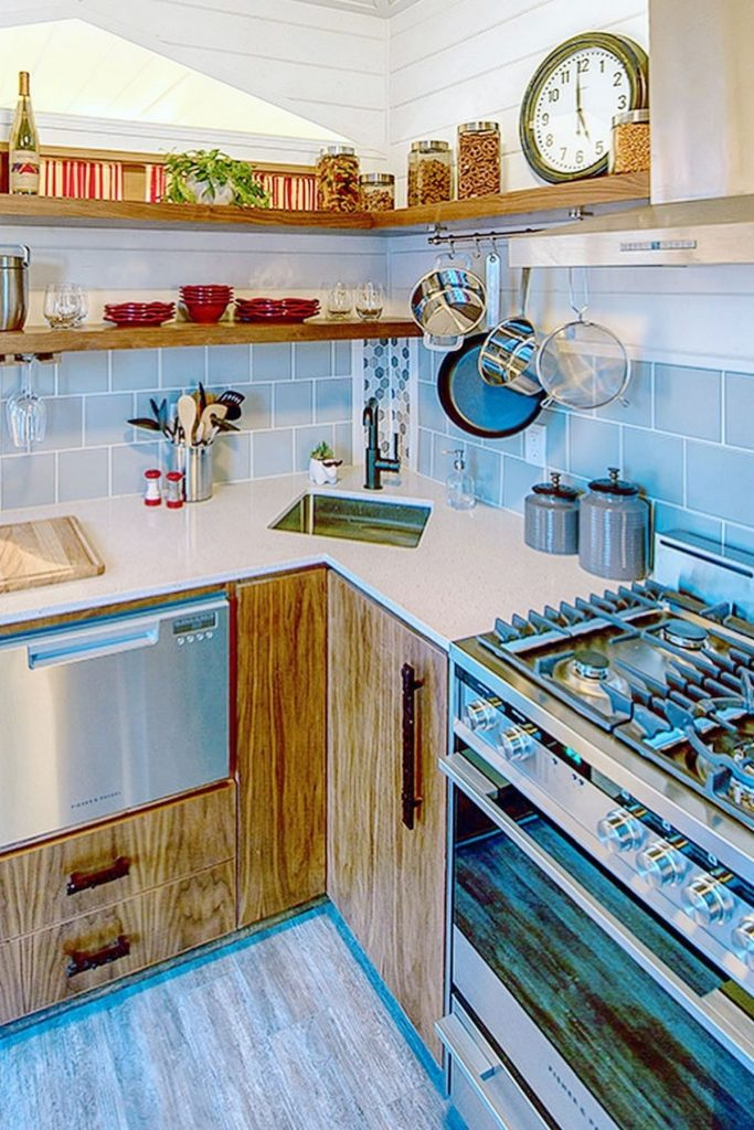 Corner kitchen with stainless steel appliances and light wood cabinets