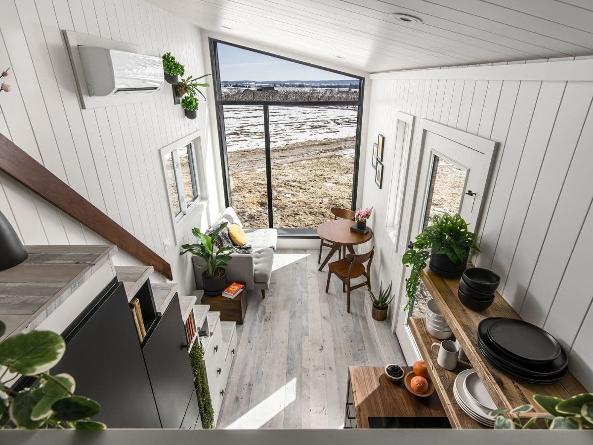 View down into tiny home living space from loft