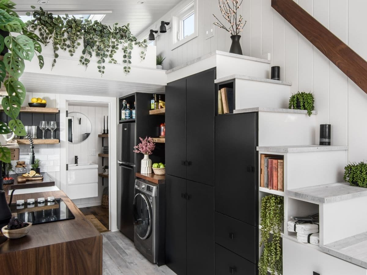 Black cabinets under white stairs