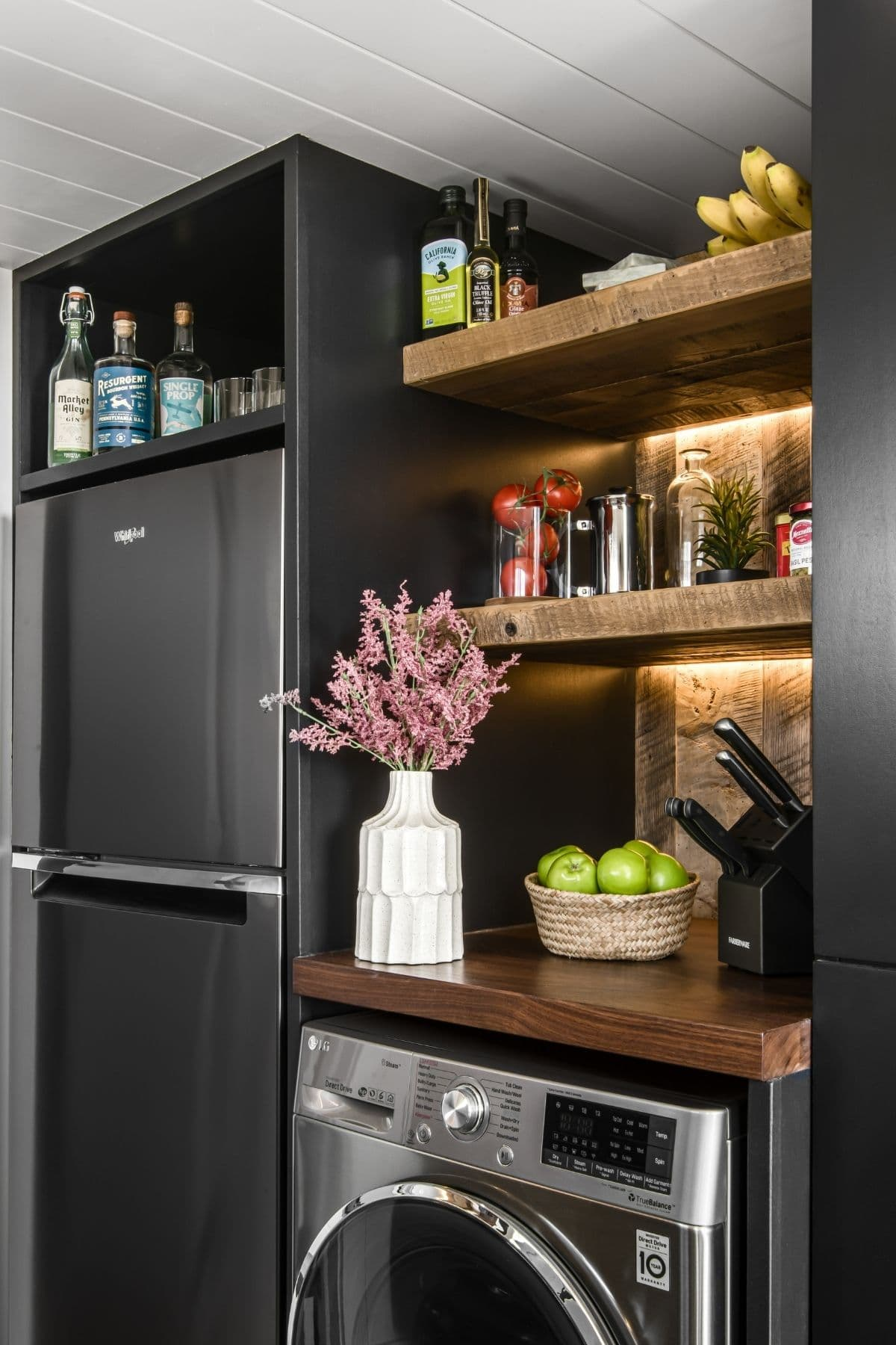 Black refrigerator in black cabinets by washer