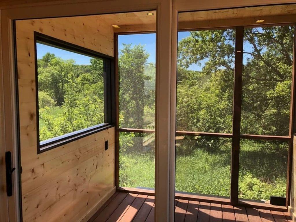 Large windows inside enclosed porch with black trim