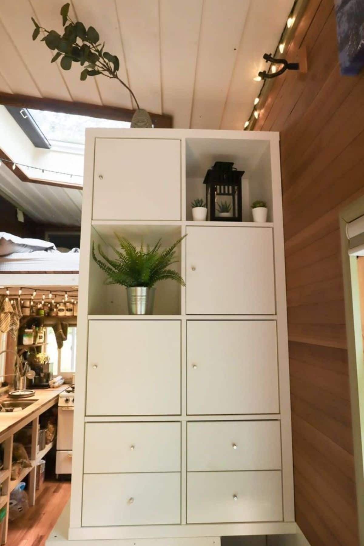 White storage cabinet with open spaces and doors