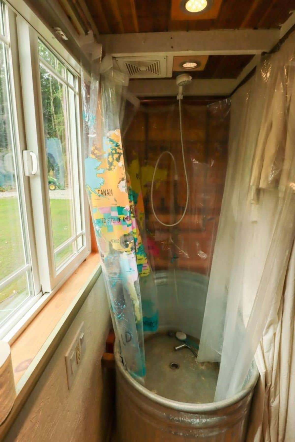 Galvanized tub shower with clear floral shower curtain