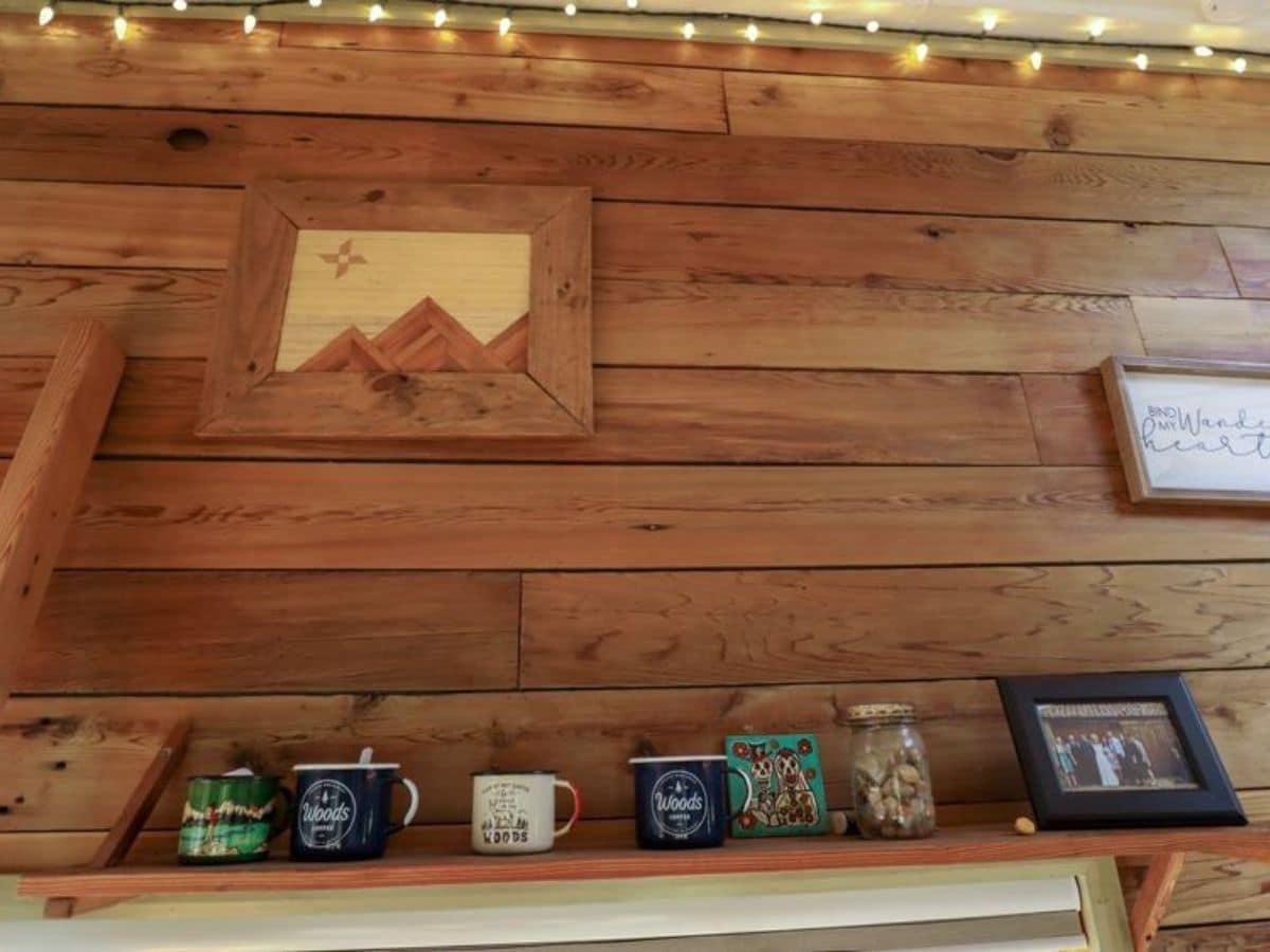 Wood wall with shelf of coffee mugs