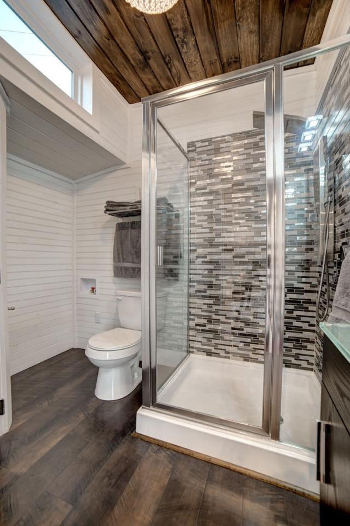 Bathroom with large tiled shower and white toilet