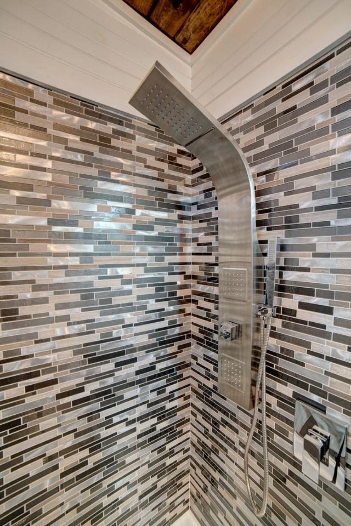 Spa shower head in tiled shower stall
