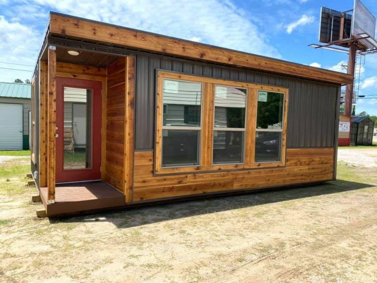 Cedar tiny house with three large windows on side