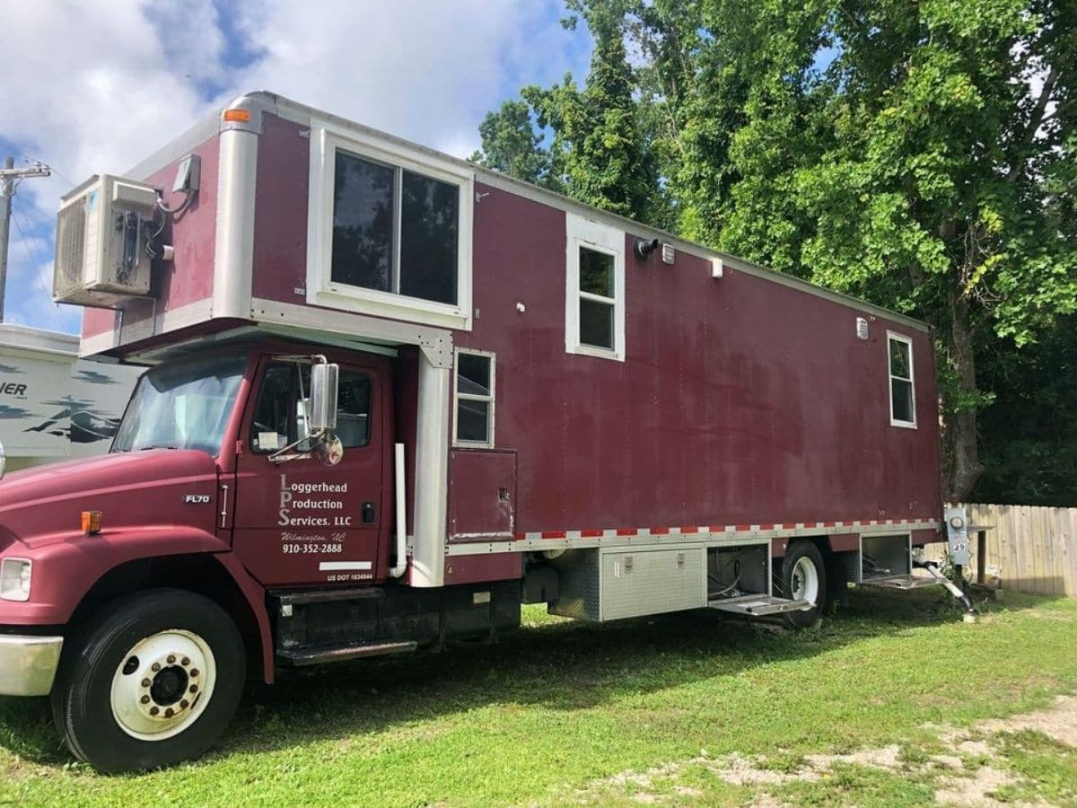 Maroon box truck with loft above cab