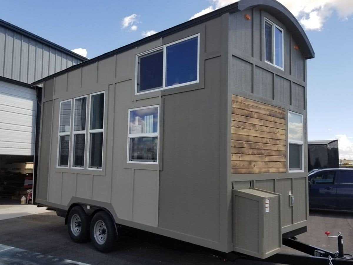 Side of tiny home with two tones of gray siding