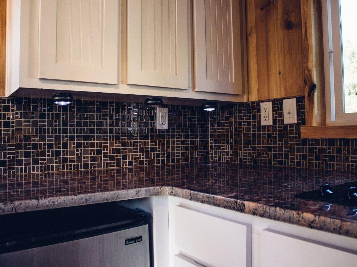 Corner under light wood cabinets in kitchen