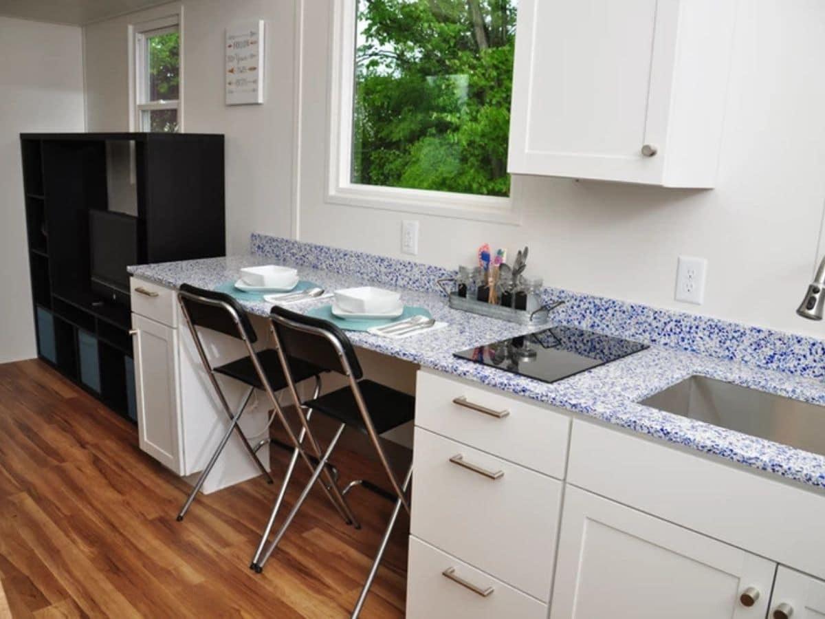 Chairs tucked under kitchen counter