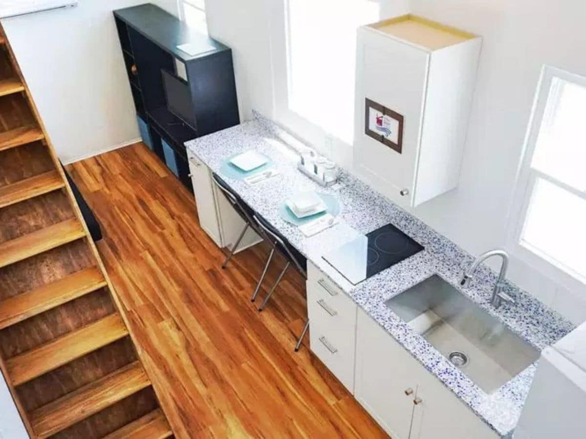 Kitchen with workspace on end next to double sink