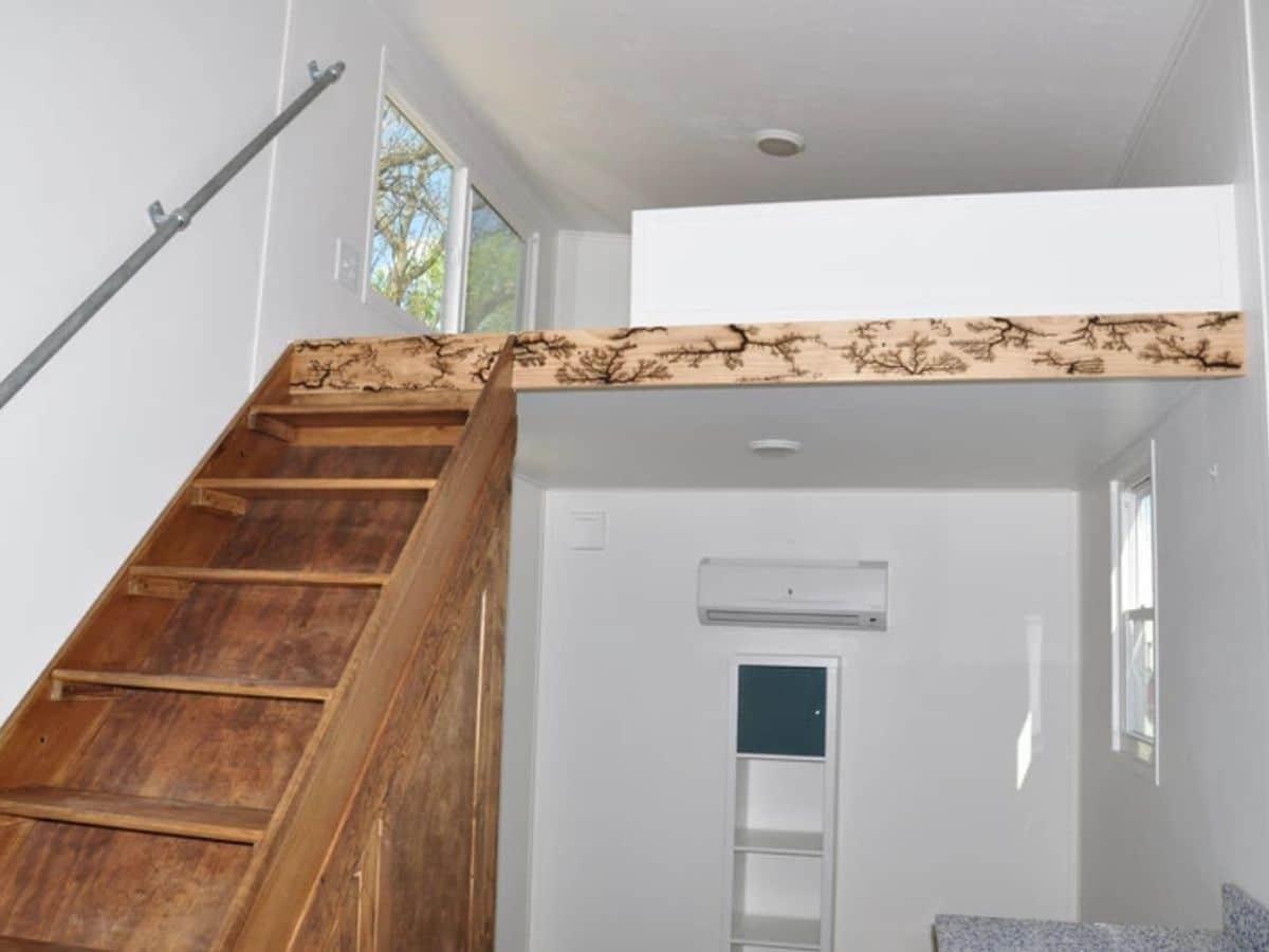 Ornate wood molding on loft wall