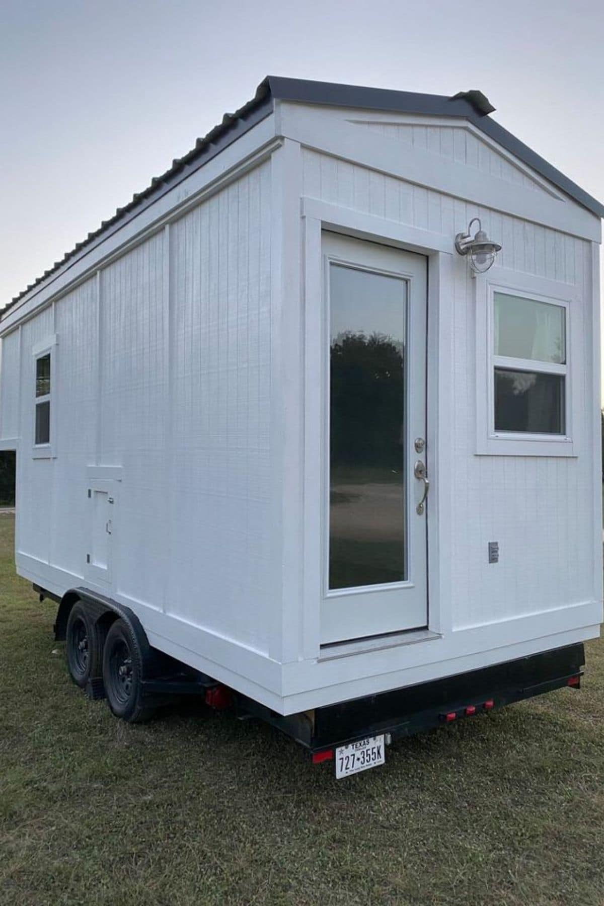 Front of tiny house on wheels showing white door