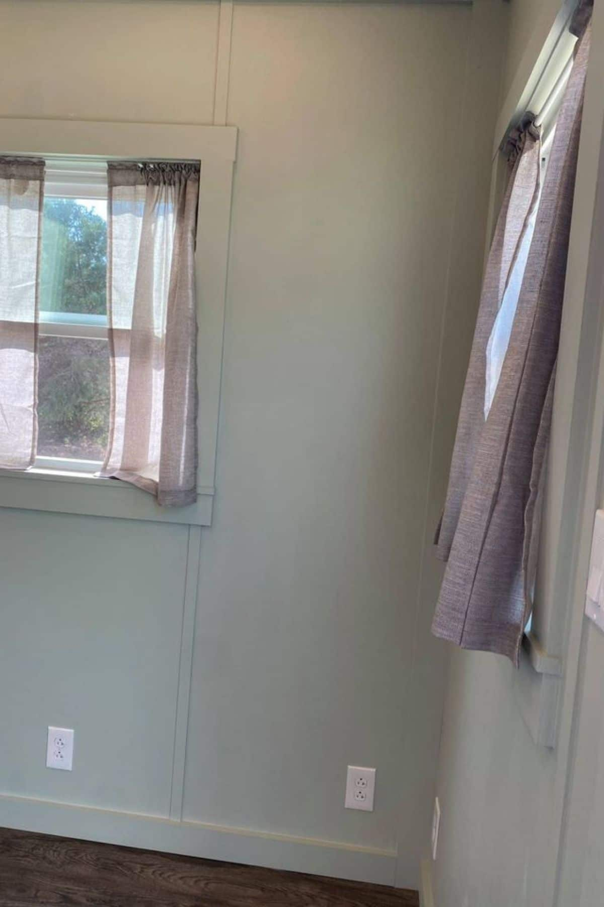 Windows against light green wall