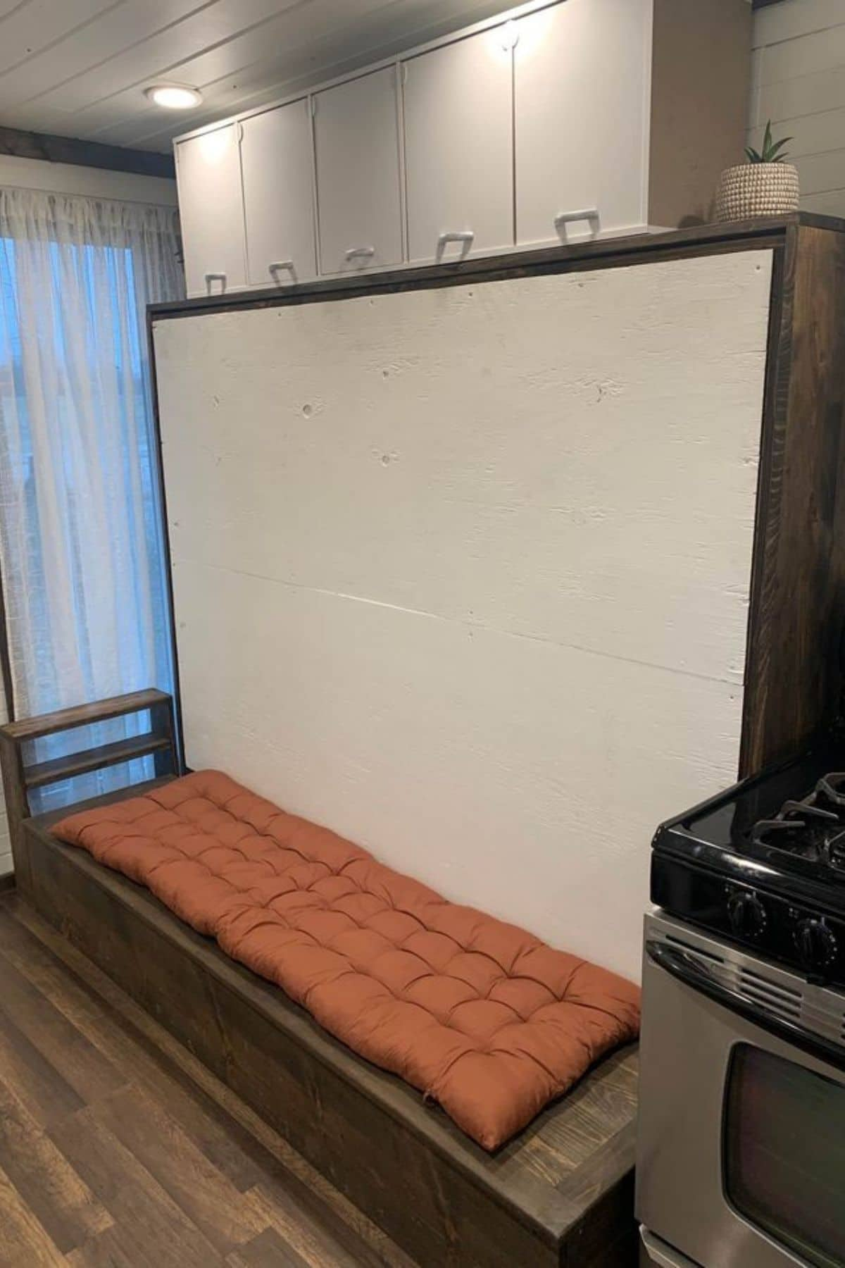 Murphy bed up in place against wall