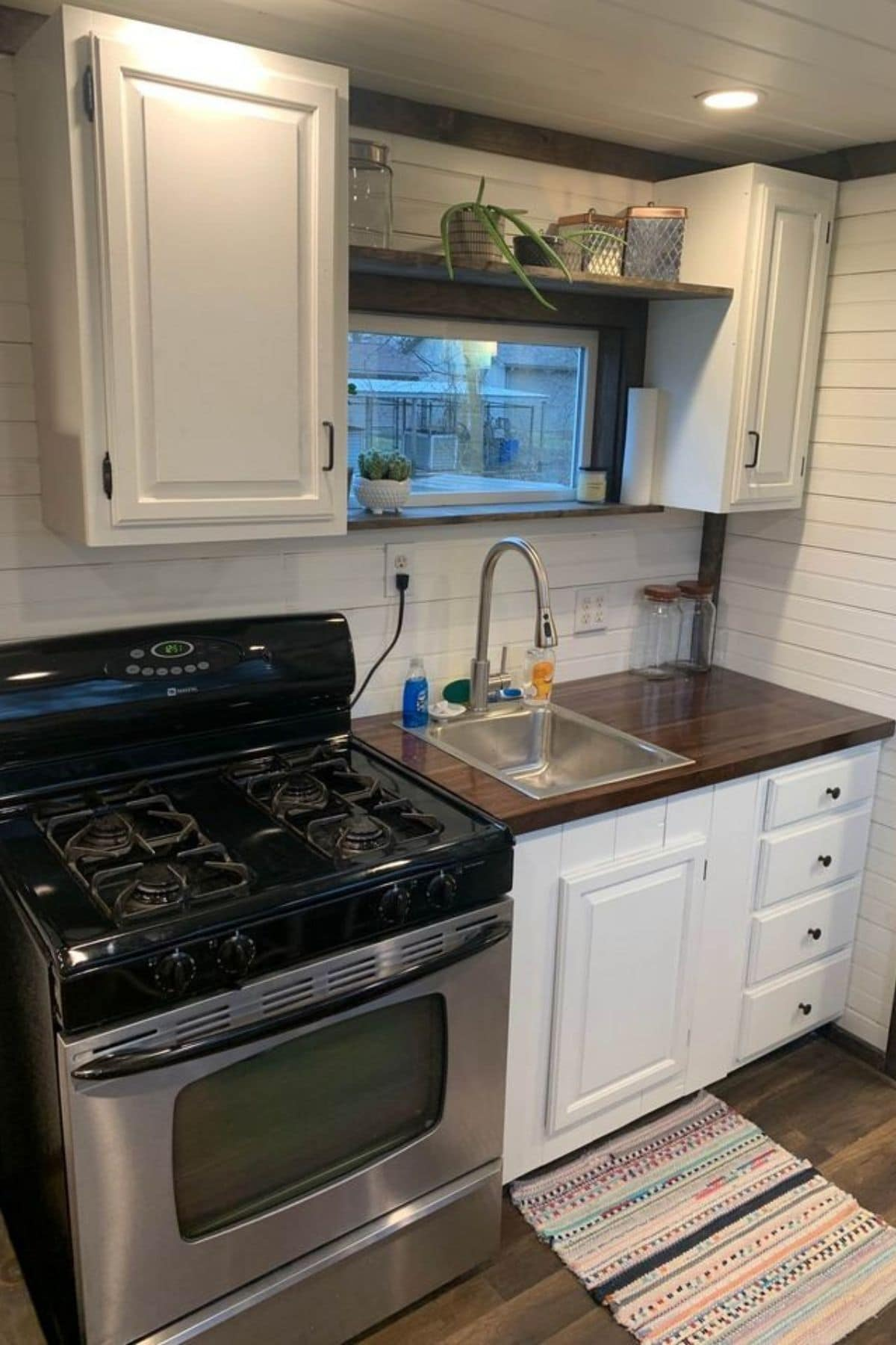 Full sized stainless steel stove inside tiny home kitchen