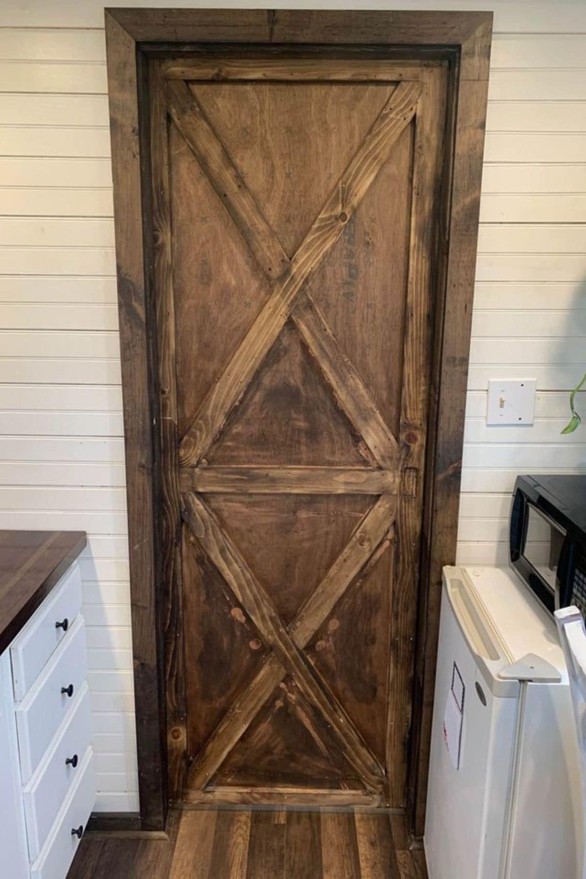 Reclaimed wood door to bathroom