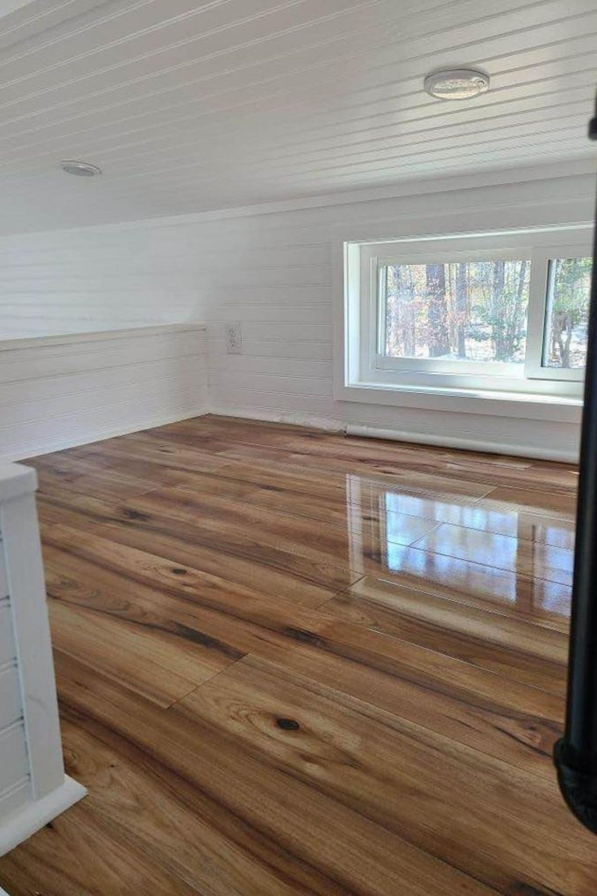 Wood floors in loft with white walls