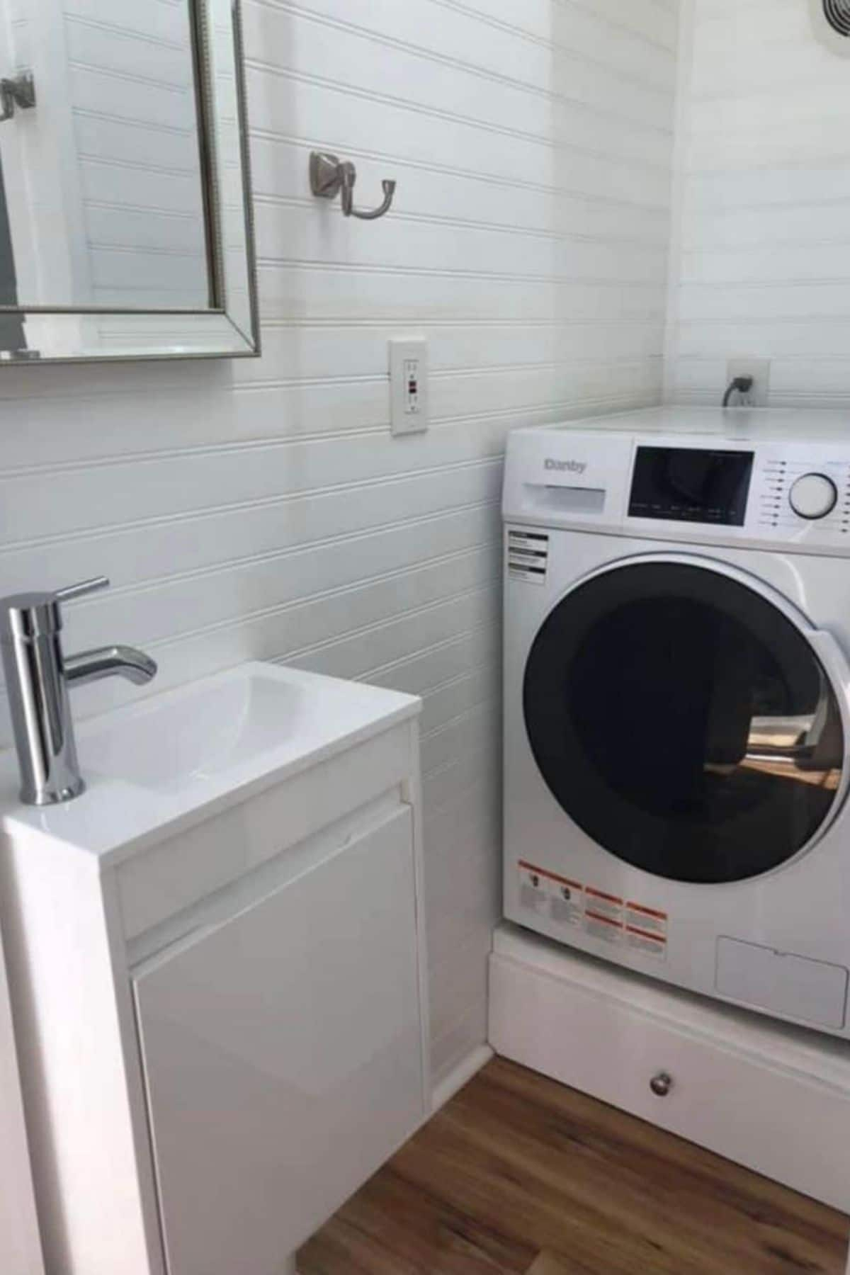 Washer and dryer combination against white wall