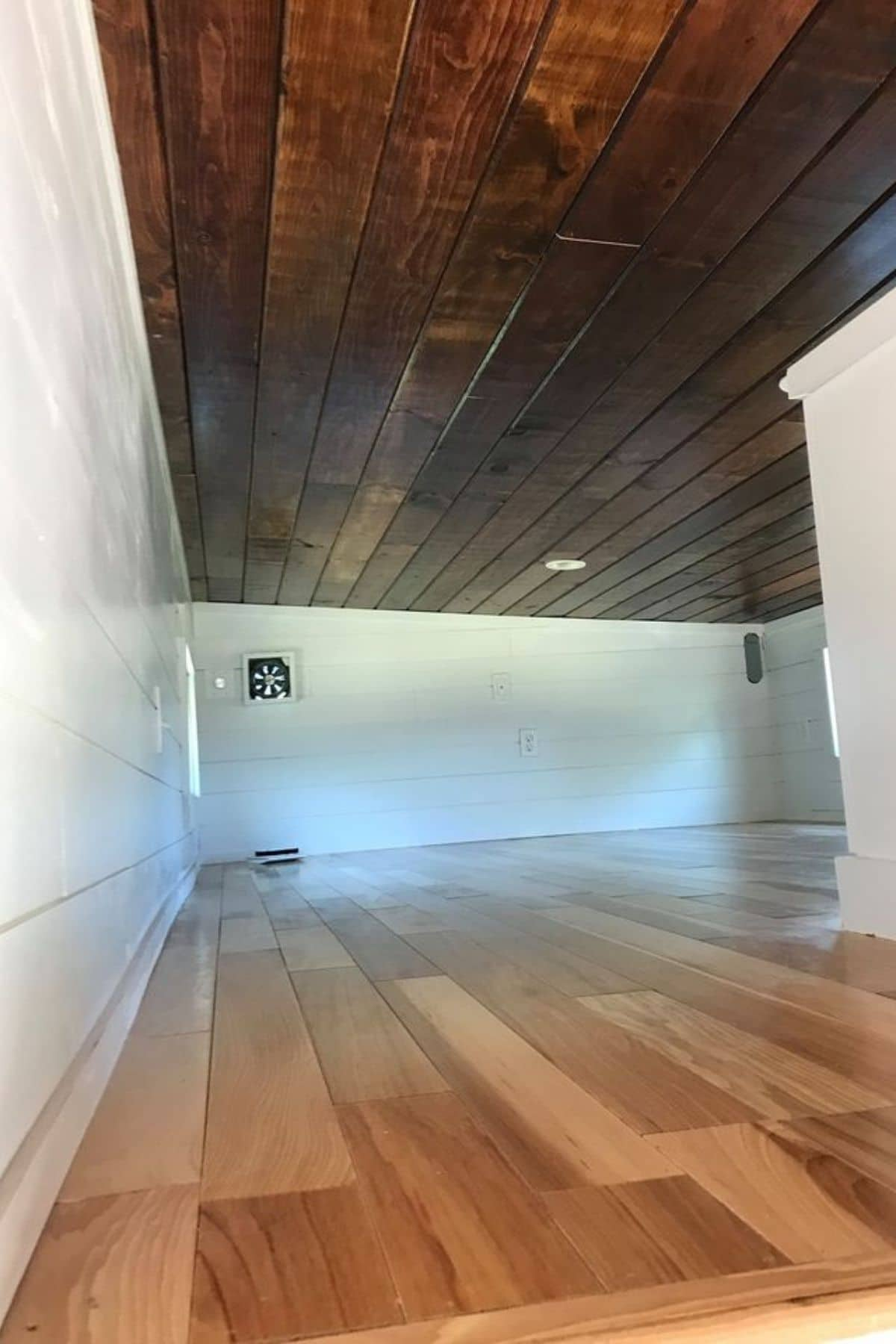 Wood floor and white walls in loft