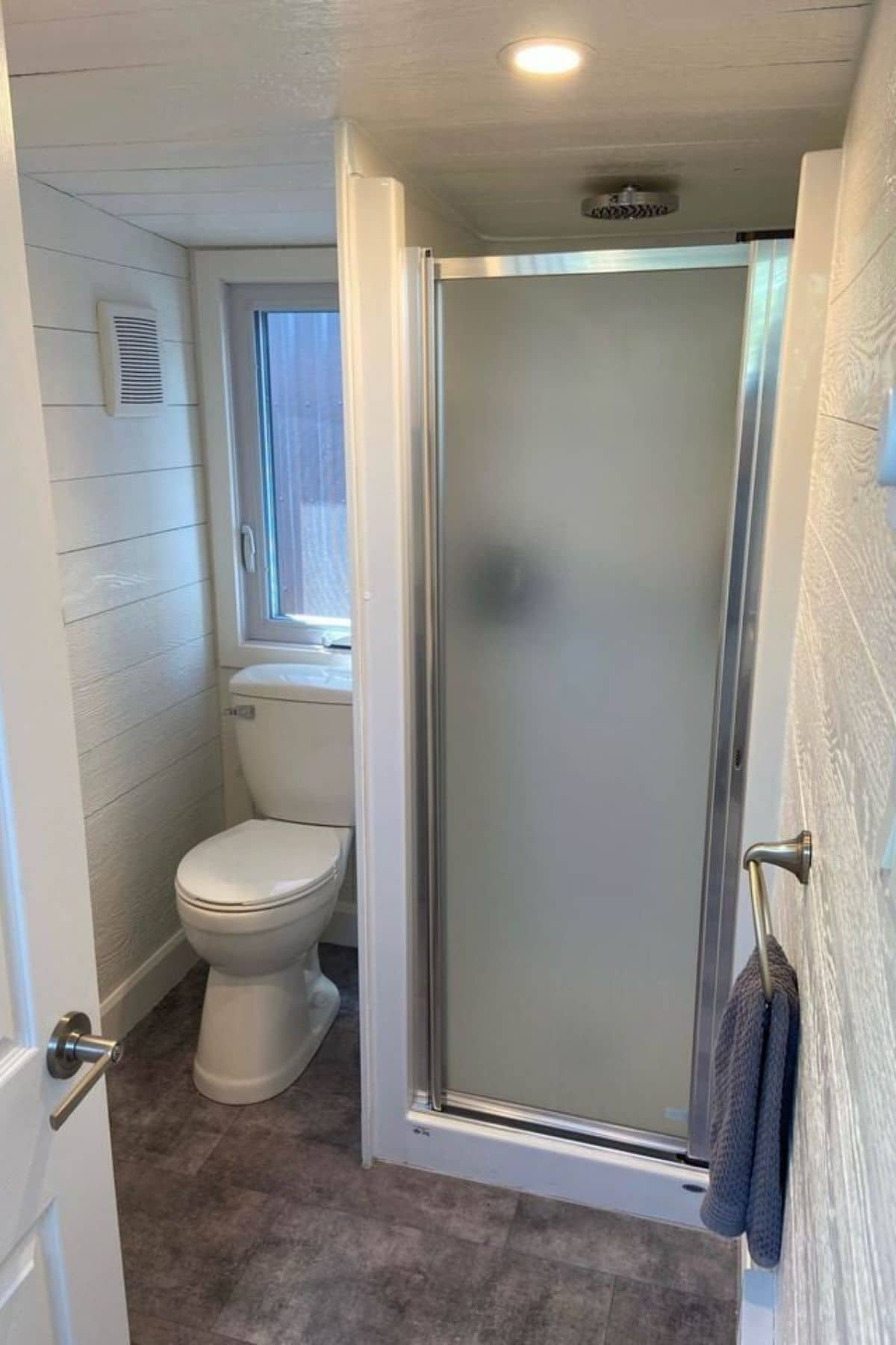 Frosted glass shower stall next to toilet