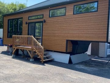 Wood siding on tiny home with gooseneck end
