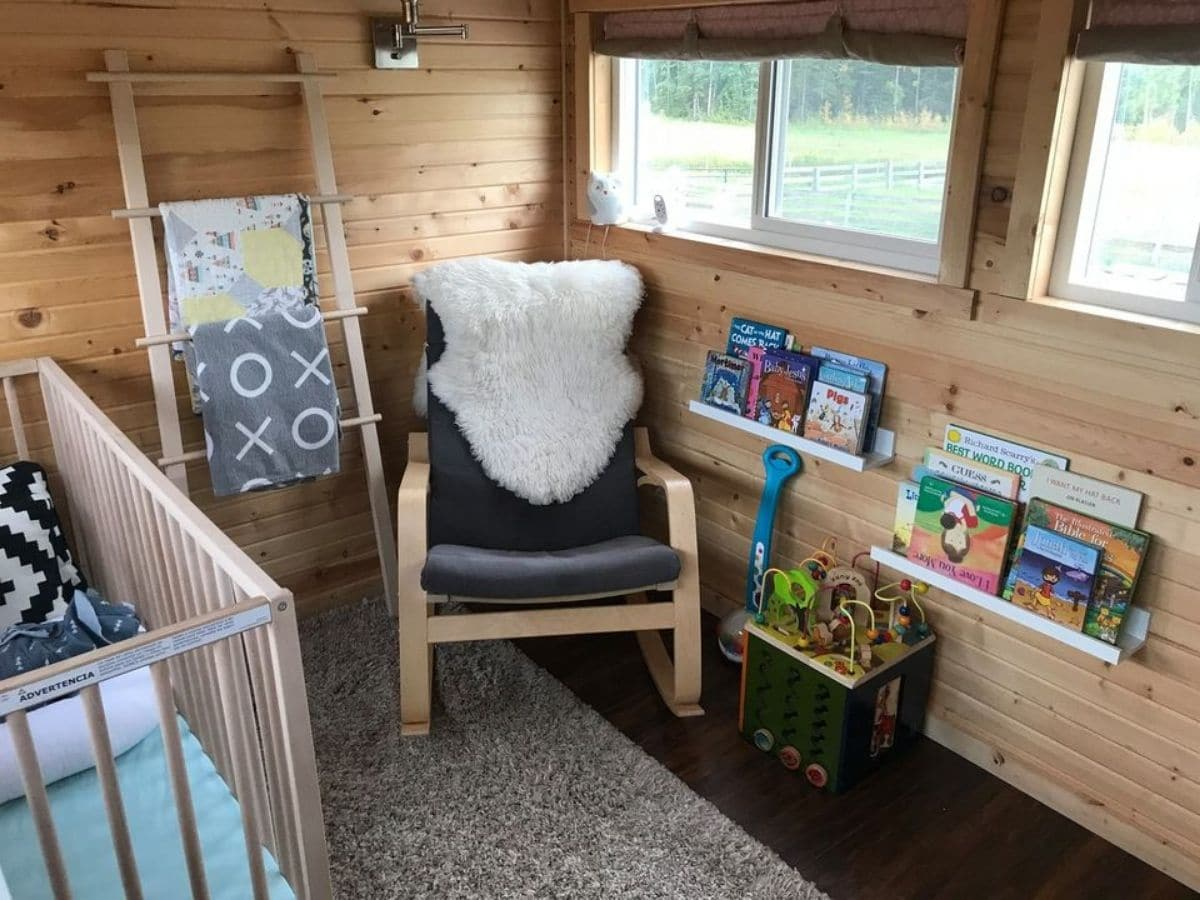 Rocking chair under window in tiny bedroom
