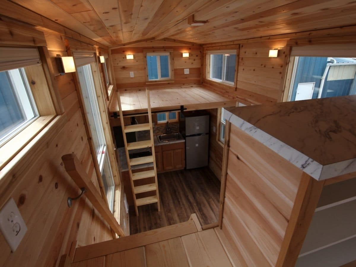 View down into main living room of tiny home from loft