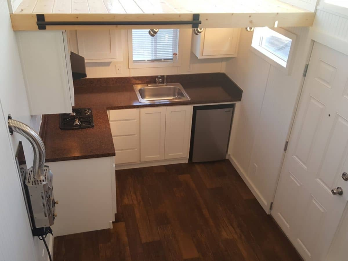 View down into kitchen from loft