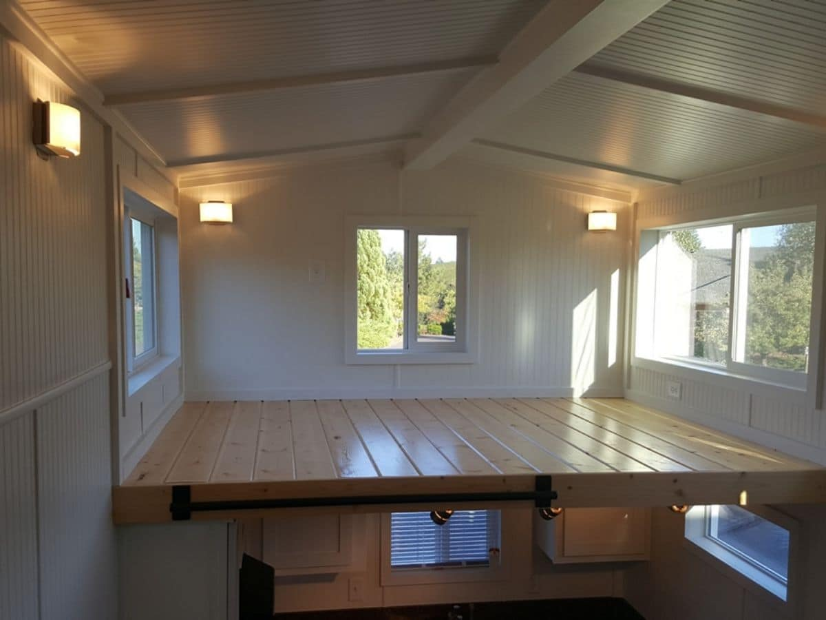 View across tiny home to loft