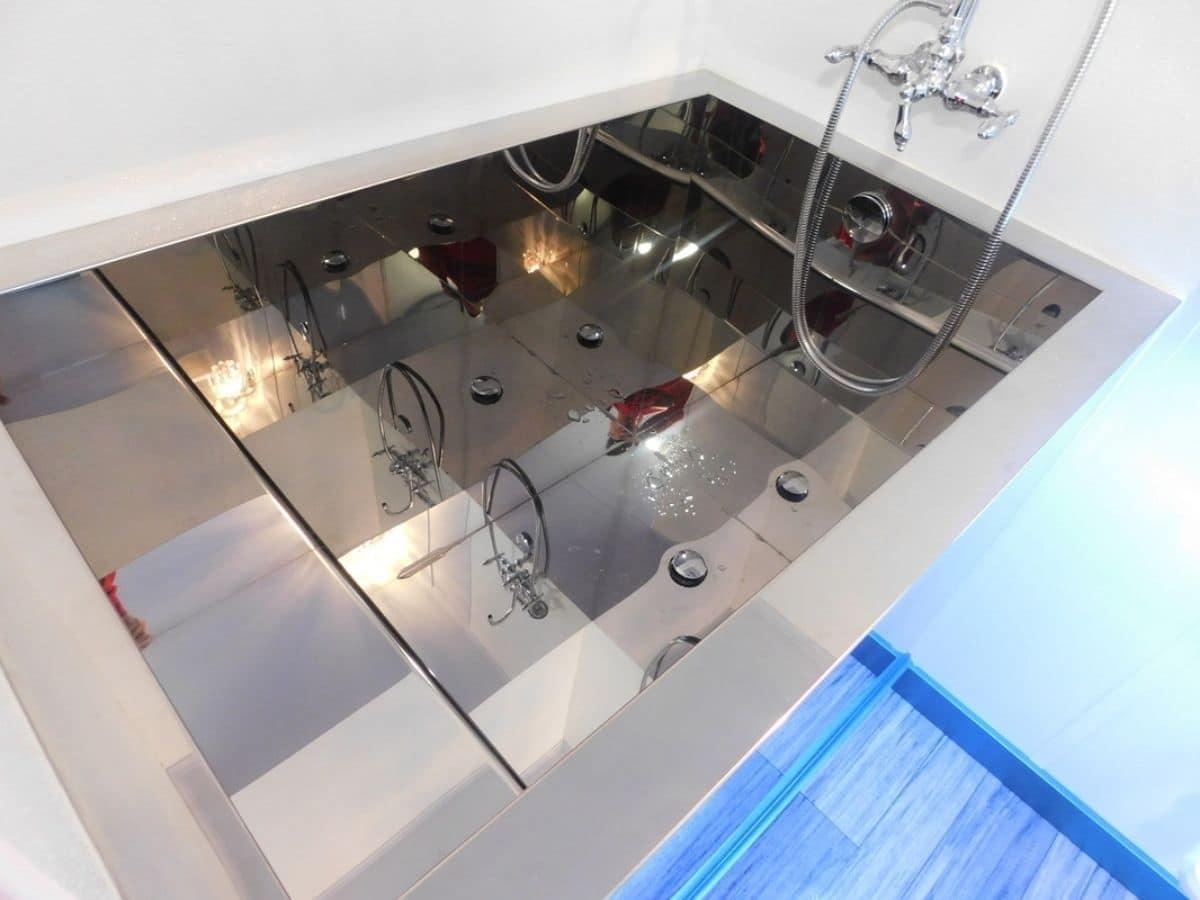 Deep stainless steel bathtub
