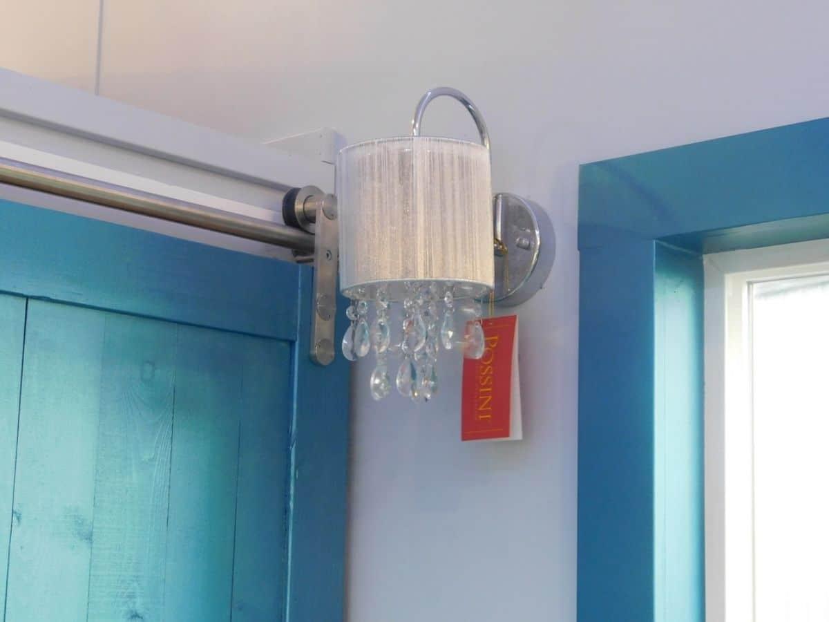 Chandelier light outside bathroom door