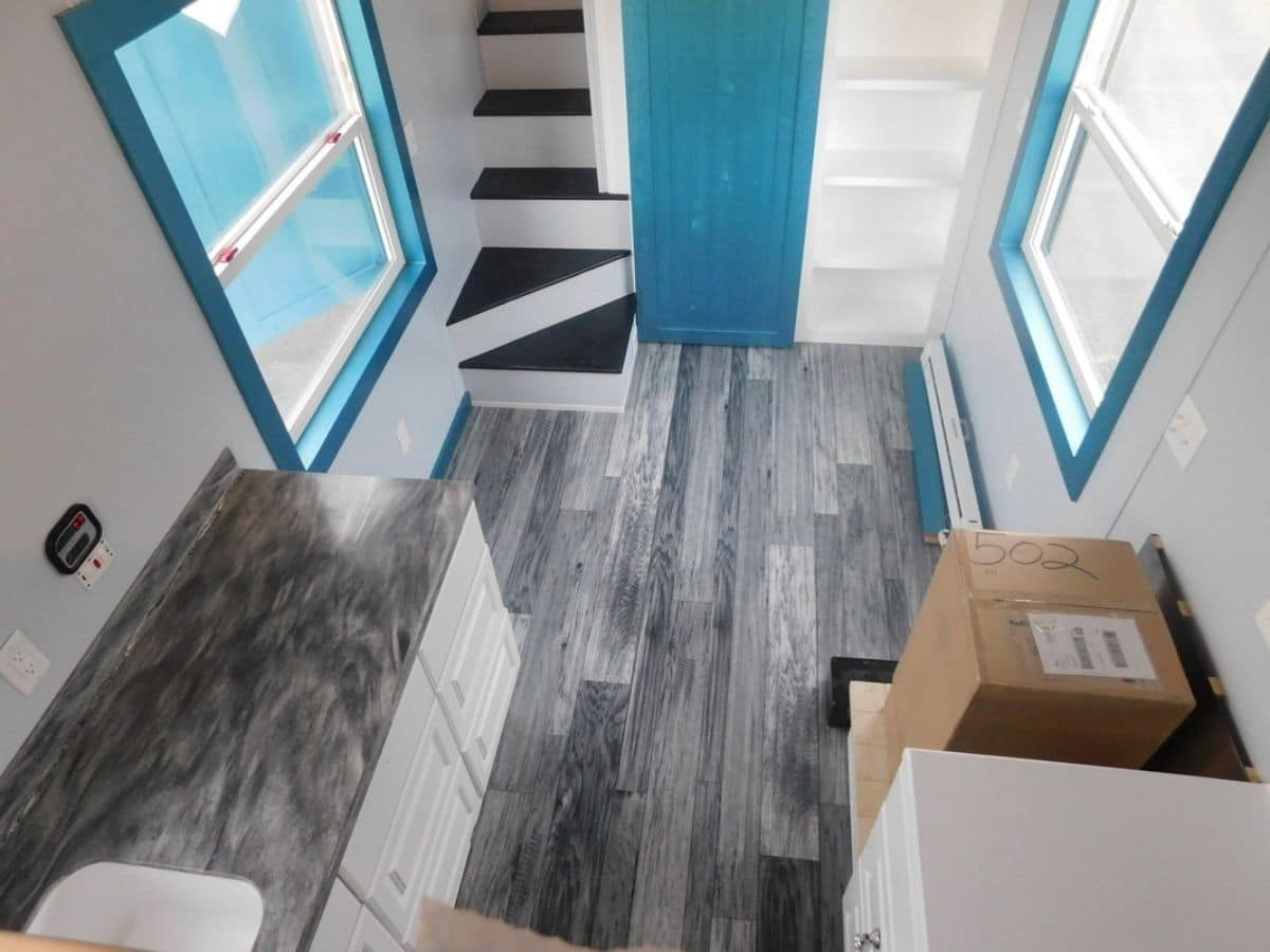 View of tiny home living room from loft